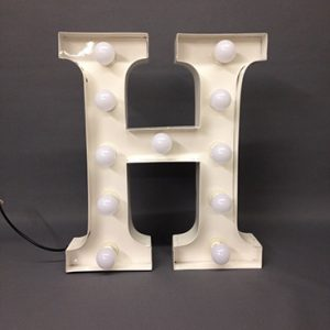 white h marquee letter
