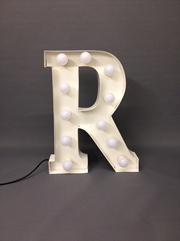 white marquee letter r