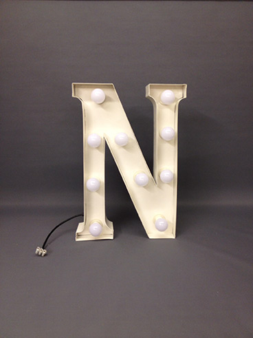 white marquee letter n