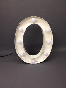 white marquee letter o