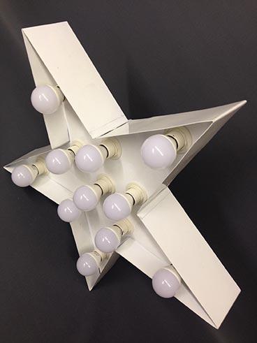 white handmade steel illuminated star