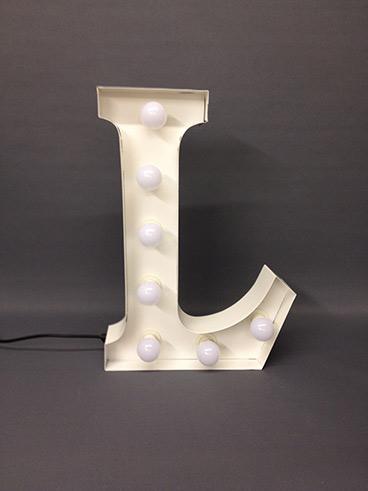 white carnival letter l