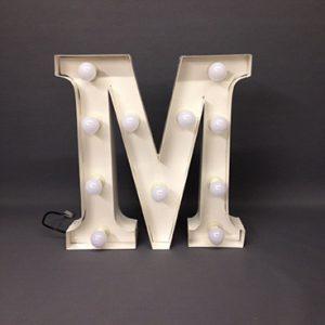 white carnival letter m